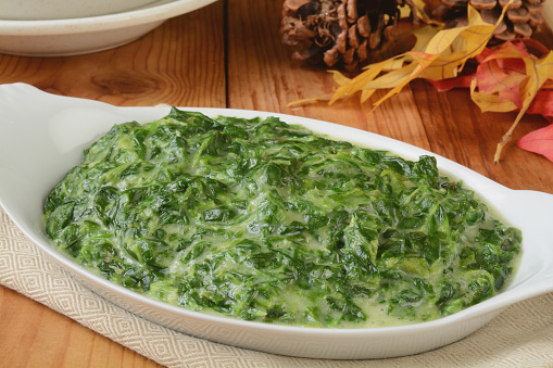 A small casserole dish of spinach in cream sauce